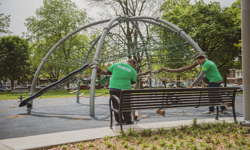 Volunteers cleaning up park playground